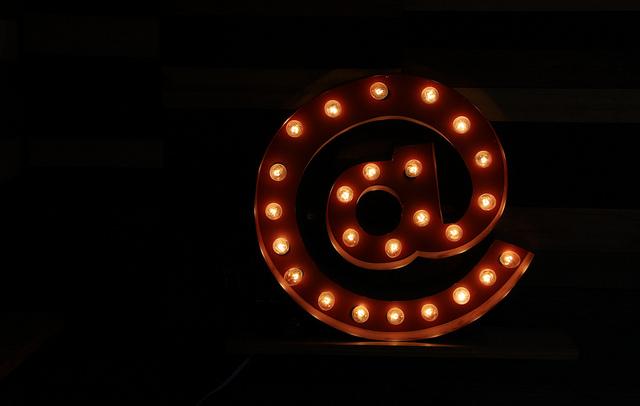 Email at (@) symbol illuminated sign