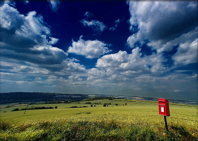 Lone postbox in a countryside landscape