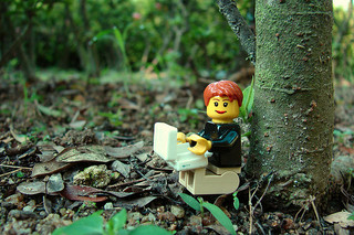 Lego figures using a laptop in the jungle